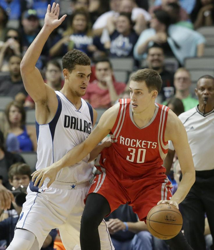 Houston Rockets forward Kyle Wiltjer (30) dribbles against Dallas Mavericks forward Dwight Powell during the second half of an NBA preseason basketball game Wednesday, Oct. 19, 2016, in Dallas. (AP Photo/LM Otero) ORG XMIT: DNA114